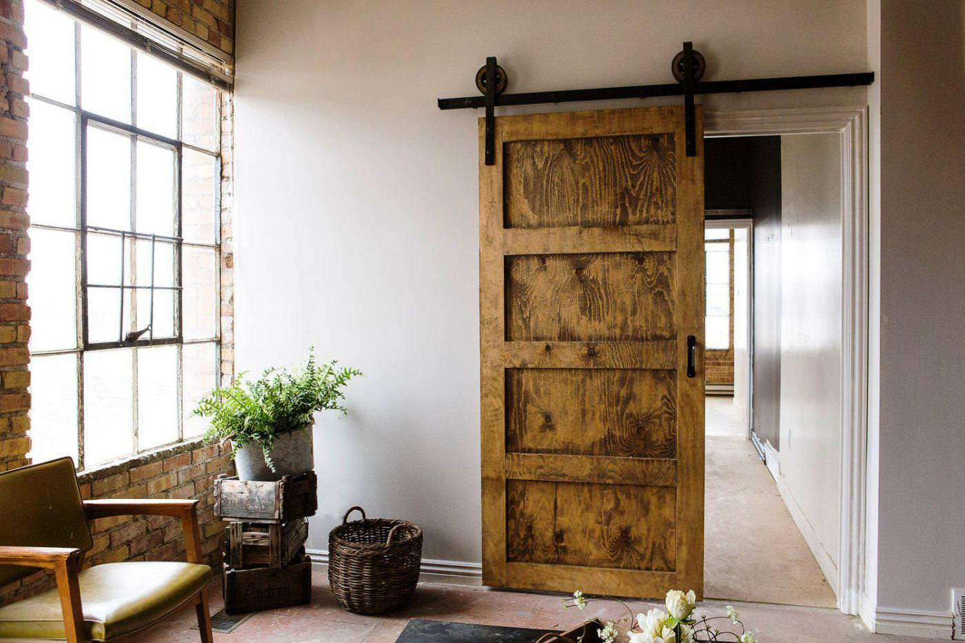 5 interior sliding barn door ideas mimi zackery for Barn door design ideas